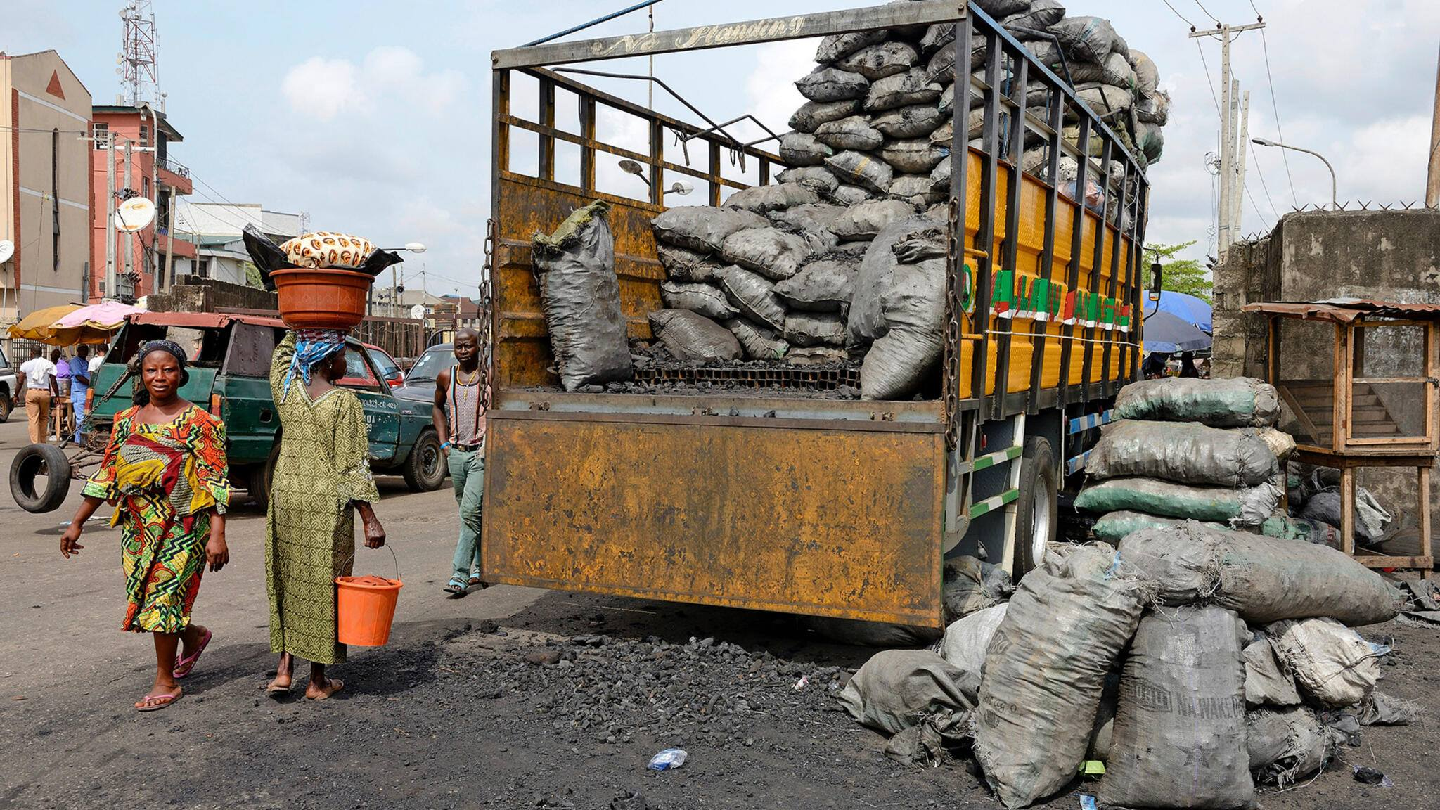 LAGOS, NIGERIA - MARCH 10 : Wood charcoal in a slum in area Sura in Lagos Island on March 10, 2016 in Lagos, Nigeria - West Africa. (Photo by Frédéric Soltan/Getty Images)