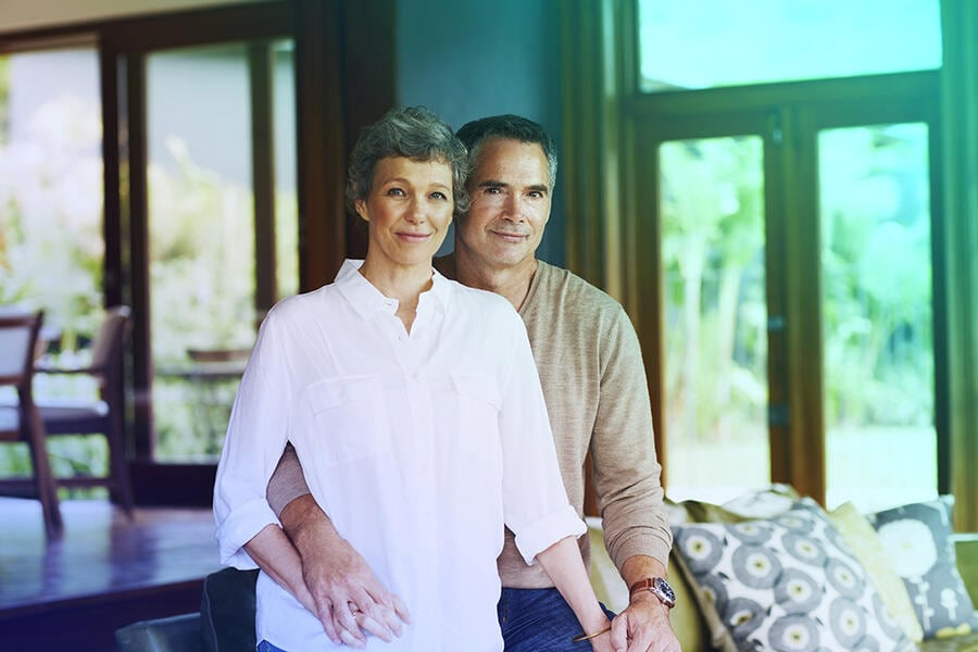 Portrait of mature couple in their living room